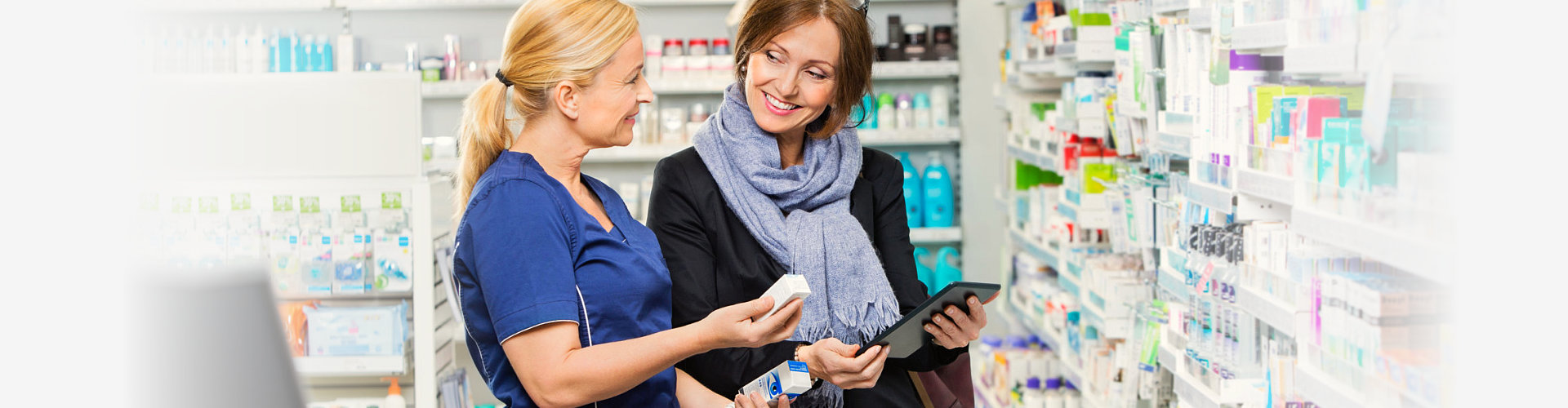 pharmacist showing eye drop to customer