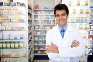 male pharmacist at pharmacy smiling
