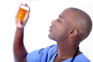 pharmacist checking a medicine bottle